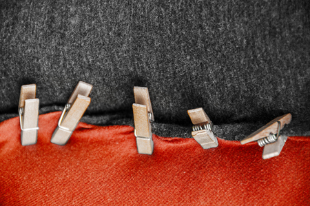 black red coalition clothes with clothespin Stock Photo