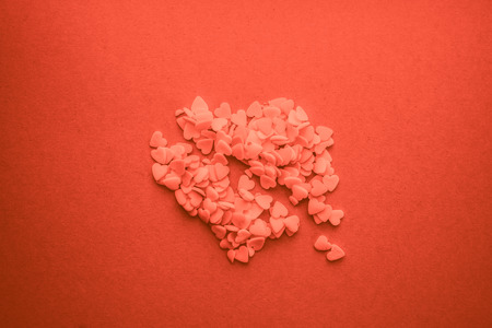 Hearts for Valentine's Day flat background in living coral pantone color Stock Photo