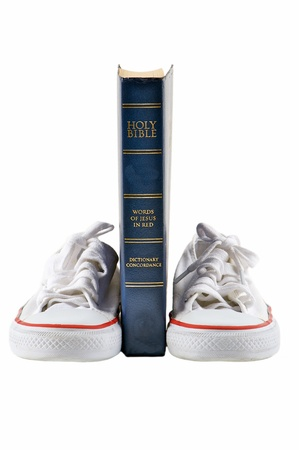 Bible and school shoe on isolated white background photo