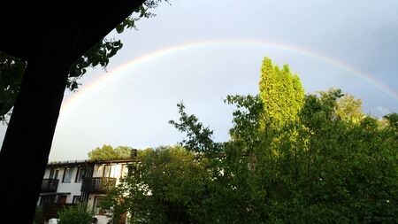 The rainbow came out after the rain in my neighborhood on the outskirts of Stockholm