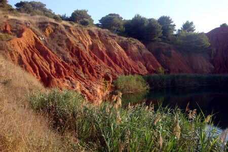 image of the lake in the red rock just outside Otranto in Puglia