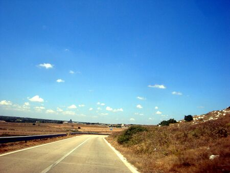 traveling along the Salento road. The very long road and the fields on the sides