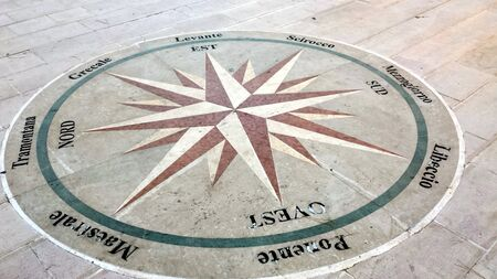 Otranto, Italy, Europe - July 11, 2016 ancient wind rose on the pavement of the square