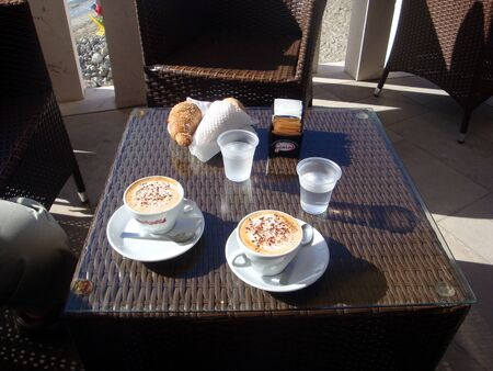 Otranto, Italy, Europe - July 11, 2016 breakfast by the sea with croissant and cappuccino Editöryel