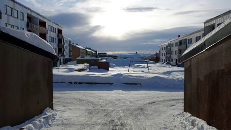 A glimpse of the buildings in a small town in the north of Sweden full of snow