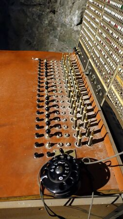 Photo of an ancient telephone switchboard dating back to the early 1900s