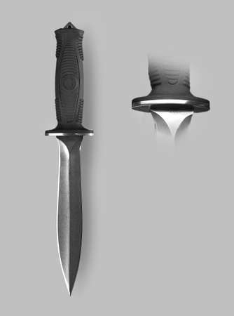stabs: Military knife with sheath on a gray background with shadow