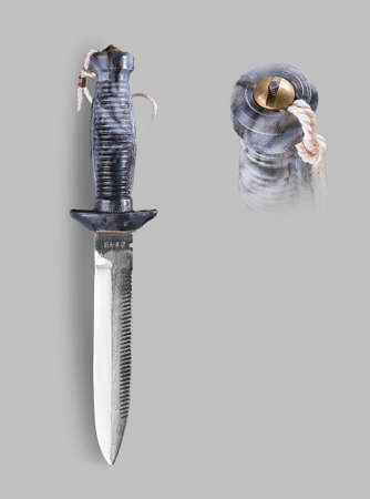 stabs: Underwater Combat knife with sheath on a gray background