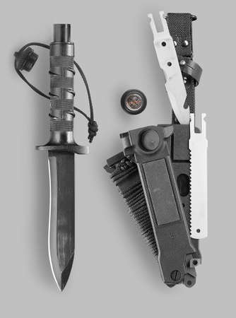 stabs: Combat survival knife with sheath on a gray background