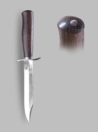 Military knife with sheath on a gray background with shadow
