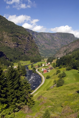 tran: Inside norwegian fjord you find this little village Stock Photo
