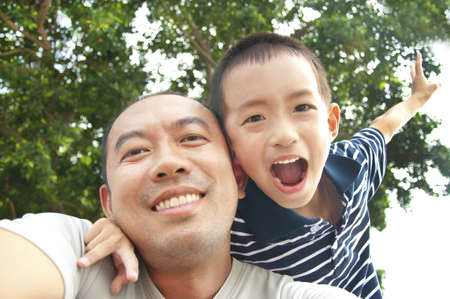 asian trees: Happy father and son