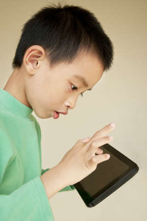 Young boy use to tablet pc photo