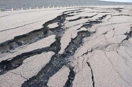 environmental problems: Cracked road after the disaster Stock Photo
