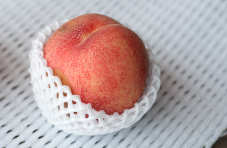fresh peaches in shockproof Stock Photo