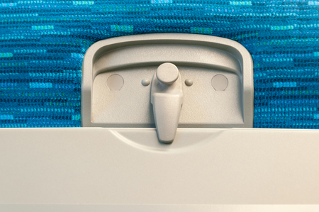 latch: Airplane Tray Table, close-up of latch and tray