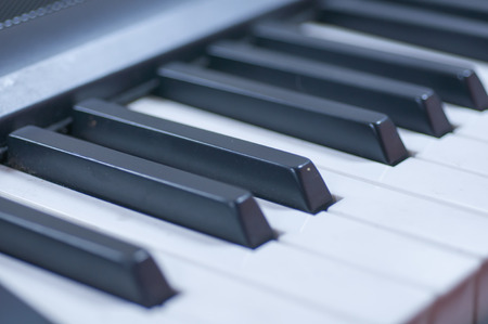 octave: Piano keys side view with shallow depth of field
