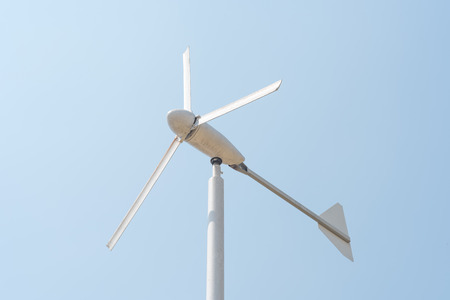 Wind energy turbine power station on clear blue sky Stock Photo