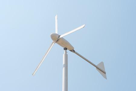 hardwearing: Wind energy turbine power station on clear blue sky Stock Photo