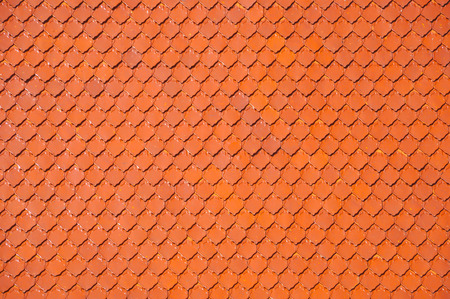 Close up the red roof tile pattern of buddhist temple in Bangkok, Thailand