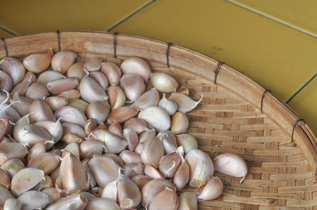 Garlic dried on wood basket background, selective focus Stock Photo