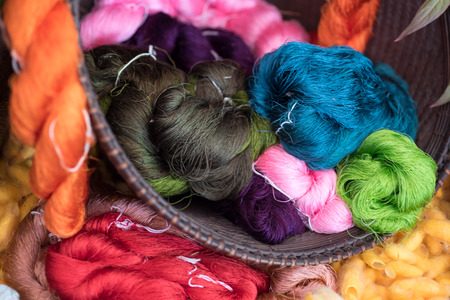Colorful silk thread rolls. Made from worm silk, selective focus Stock Photo
