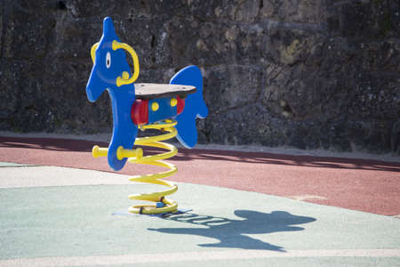 Toy horse in a playground photo