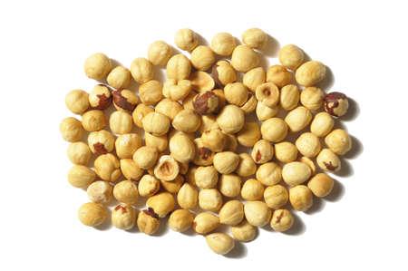 Toasted hazelnuts on white background