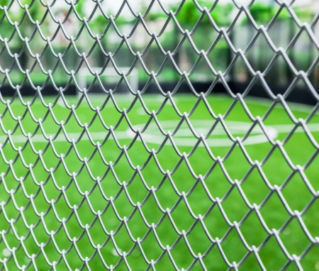 Metal mesh with soccer court photo