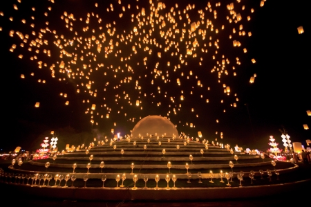 lunar month: People release sky lanterns to worship Buddhas relics in Yi Peng festival on November 8,2008 in Chiangmai,Thailand. This festival occurs on every the 12th Thai lunar month. Stock Photo