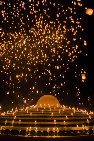 People release sky lanterns to worship Buddhas relics in Yi Peng festival on November 8,2008 in Chiangmai,Thailand. This festival occurs on every the 12th Thai lunar month. photo