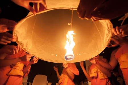 lunar month: People release sky lanterns to worship Buddhas relics in Yi Peng festival on November 8,2008 in Chiangmai,Thailand. This festival occurs on every the 12th Thai lunar month. Editorial