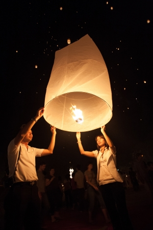 People release sky lanterns to worship Buddhas relics in Yi Peng festival on November 8,2008 in Chiangmai,Thailand. This festival occurs on every the 12th Thai lunar month.