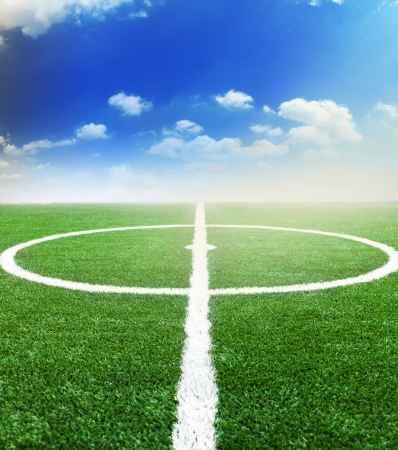 green soccer field with the blue sky