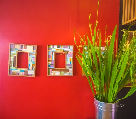 frames on red wall photo