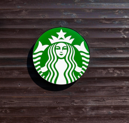 Kanagawa,Japan- January 12: logo of a Starbucks store in the city centre on Jan 12, 2014 in Kanagawa,Japan. Starbucks is the worlds largest coffee house with over 20,000 stores in 61 countries.