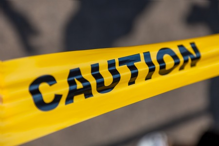 roped off: Yellow Plastic Caution Tape Stock Photo