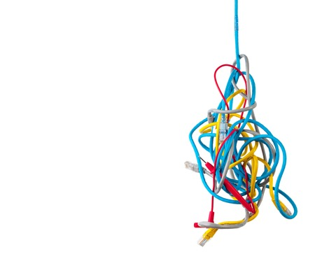 Cluster of chaotic tangled network cables isolated on white background