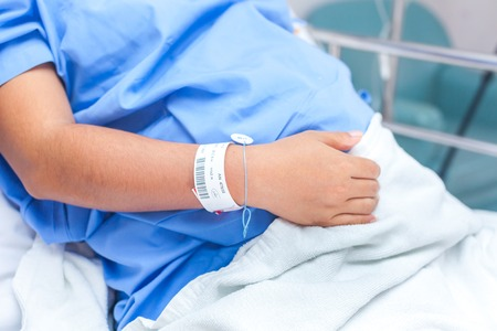 female catheter: sick lady lying in hospital bed Stock Photo