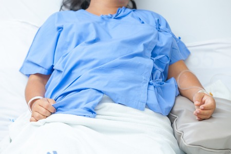 female catheter: sick lady lying in hospital bed Stock Photo