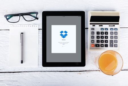 dropbox: Chiang mai,THAILAND Fab 25, 2015:Closeup photo of Dropbox icon on tablet screen. Editorial