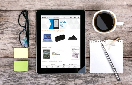 marketed: Chiang mai,THAILAND Fab 25, 2015:The Amazon Kindle is a series of e-book readers designed and marketed by Amazon.com. Amazon Kindle devices enable users to shop for, download, browse, and read e-books, newspapers, magazines and other digital media via wir Editorial