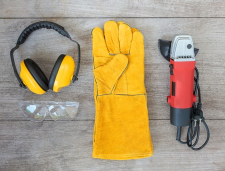 leather gloves: set of tools on wooden board, ear muffs,angle grinder,leather gloves