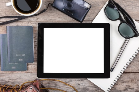 passport: Preparation for travel,outfit, tablet ,passport, camera on wooden table Stock Photo