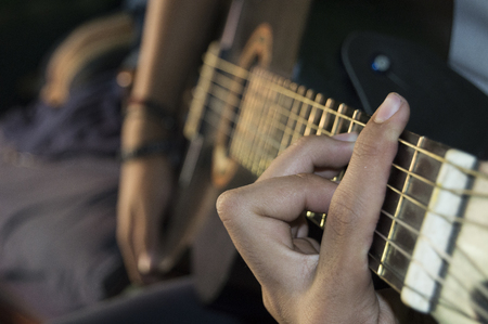minors: fingers guitar chord doing Stock Photo