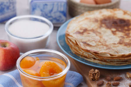 shrove: Golden pancakes on a blue plate. Traditional Russian dish on Shrove Tuesday Stock Photo