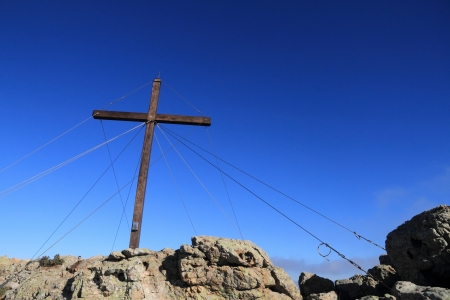 The large wooden cross at the top of Capu di a Veta behind the citadel town of Calvi in the Balagne region of Corsica photo