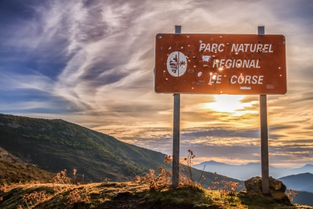 corse: Parc Natural De Corse signpost riddled with hunter Stock Photo