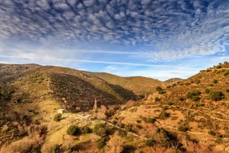 Tumbled down farm ruins near Col de San Colombano photo