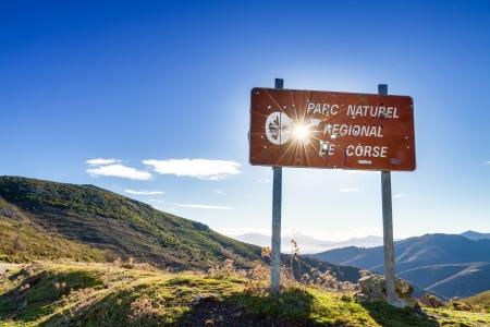 parc naturel: Parc Natural De Corse signpost riddled with hunter Stock Photo